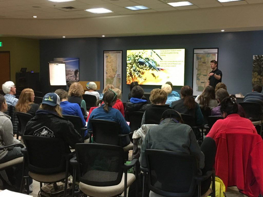 Dr. Seth Davis presenting local pollinator information to a group of volunteers.
