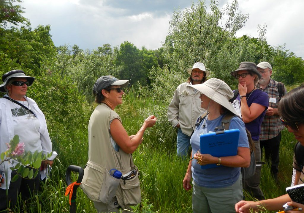 Ecologist Denise Culver in the field with workshop participants.