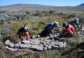 Wildlands Restoration Volunteers build a one rock dam, West Flat Top Mountain. Photo by Betsy Neely.