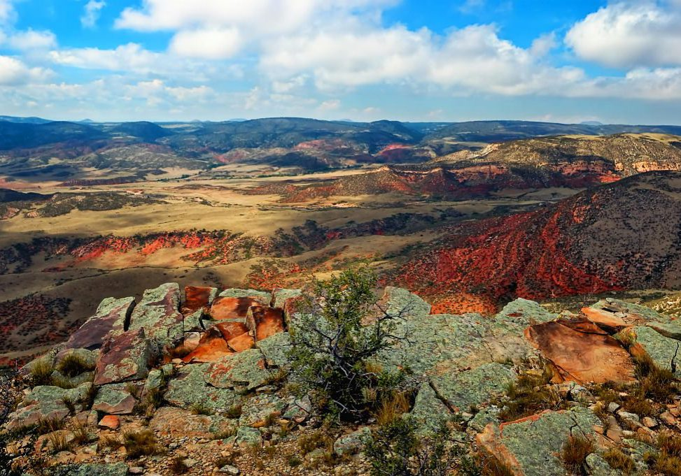 A view from the rim at Soapstone Prairie Natural Area looking into Red Mountain Open Space in NE Colorado by Michael Menefee.