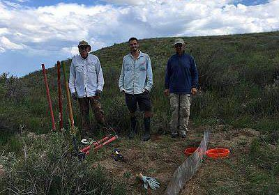 Zoologists after completing lizard pitfall traps in Pinyon Canyon.